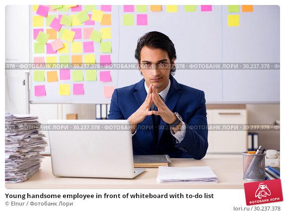 Купить «Young handsome employee in front of whiteboard with to-do list», фото № 30237378, снято 16 октября 2018 г. (c) Elnur / Фотобанк Лори
