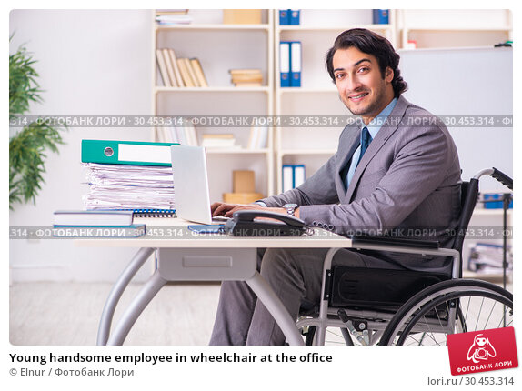 Young handsome employee in wheelchair at the office. Стоковое фото, фотограф Elnur / Фотобанк Лори