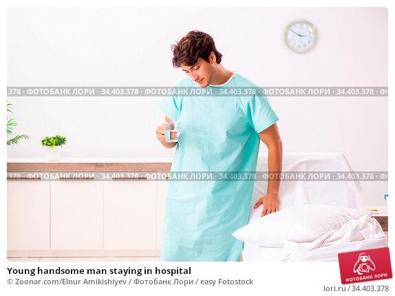 Young handsome man staying in hospital. Стоковое фото, фотограф Zoonar.com/Elnur Amikishiyev / easy Fotostock / Фотобанк Лори
