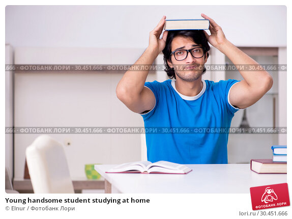 Young handsome student studying at home. Стоковое фото, фотограф Elnur / Фотобанк Лори