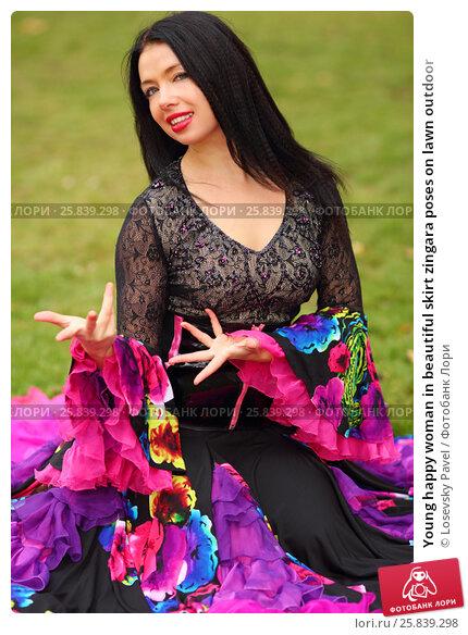 Купить «Young happy woman in beautiful skirt zingara poses on lawn outdoor», фото № 25839298, снято 15 октября 2015 г. (c) Losevsky Pavel / Фотобанк Лори