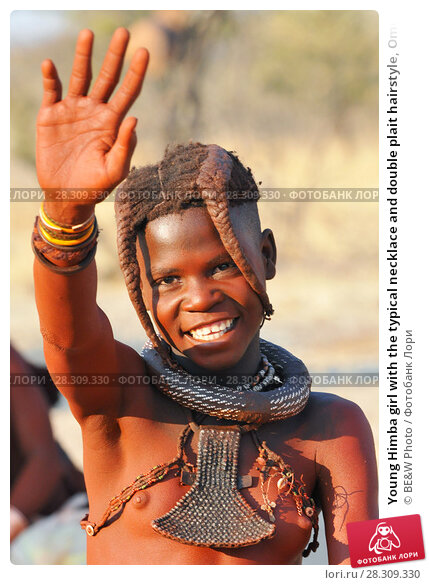 Купить «Young Himba girl with the typical necklace and double plait hairstyle, Omuramba, Kaokoland, Kunene, Namibia», фото № 28309330, снято 27 апреля 2018 г. (c) BE&W Photo / Фотобанк Лори