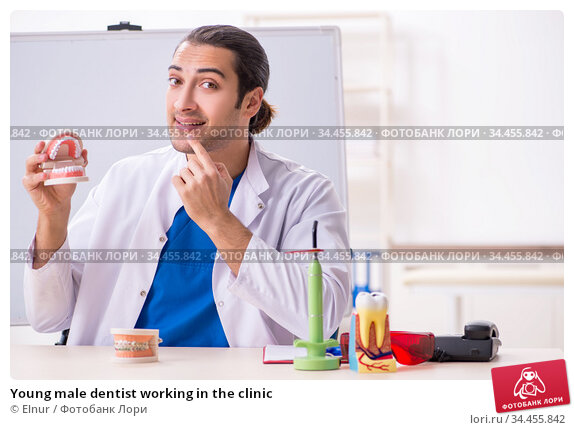 Young male dentist working in the clinic. Стоковое фото, фотограф Elnur / Фотобанк Лори