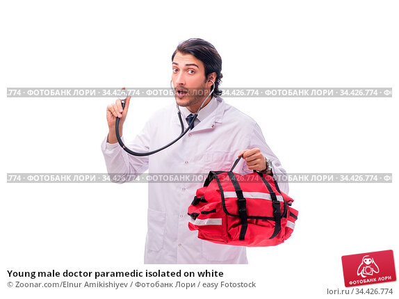 Young male doctor paramedic isolated on white. Стоковое фото, фотограф Zoonar.com/Elnur Amikishiyev / easy Fotostock / Фотобанк Лори