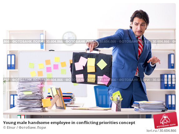 Купить «Young male handsome employee in conflicting priorities concept», фото № 30604866, снято 7 января 2019 г. (c) Elnur / Фотобанк Лори