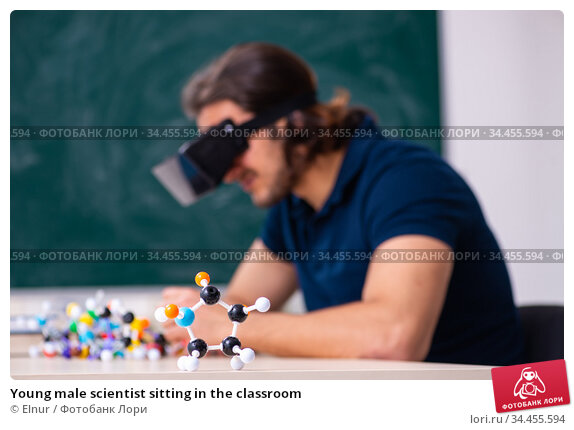 Young male scientist sitting in the classroom. Стоковое фото, фотограф Elnur / Фотобанк Лори