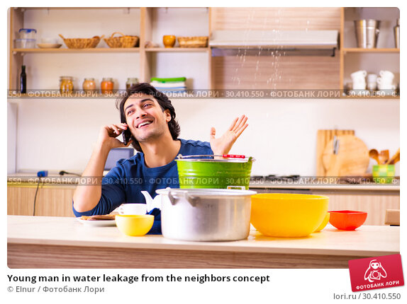 Купить «Young man in water leakage from the neighbors concept», фото № 30410550, снято 22 декабря 2018 г. (c) Elnur / Фотобанк Лори