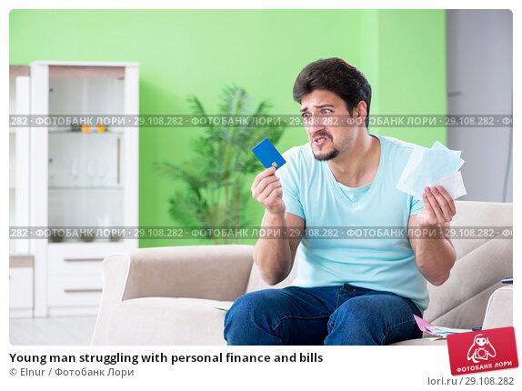 Купить «Young man struggling with personal finance and bills», фото № 29108282, снято 7 мая 2018 г. (c) Elnur / Фотобанк Лори