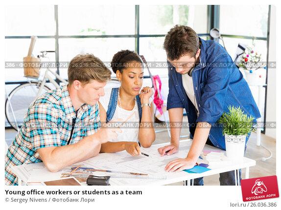 Купить «Young office workers or students as a team», фото № 26036386, снято 13 декабря 2014 г. (c) Sergey Nivens / Фотобанк Лори