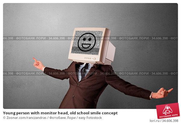 Young person with monitor head, old school smile concept. Стоковое фото, фотограф Zoonar.com/ranczandras / easy Fotostock / Фотобанк Лори
