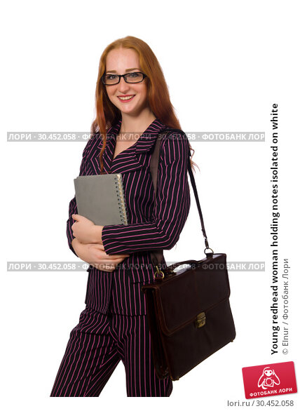 Young redhead woman holding notes isolated on white. Стоковое фото, фотограф Elnur / Фотобанк Лори