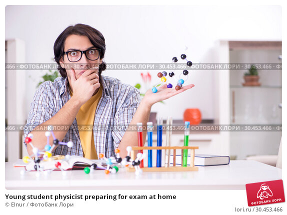 Young student physicist preparing for exam at home. Стоковое фото, фотограф Elnur / Фотобанк Лори