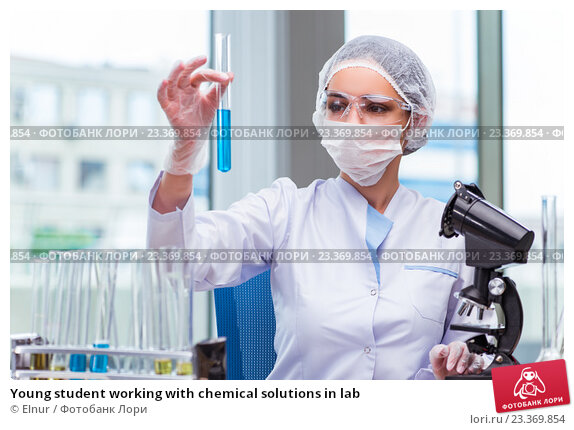 Купить «Young student working with chemical solutions in lab», фото № 23369854, снято 7 июля 2016 г. (c) Elnur / Фотобанк Лори