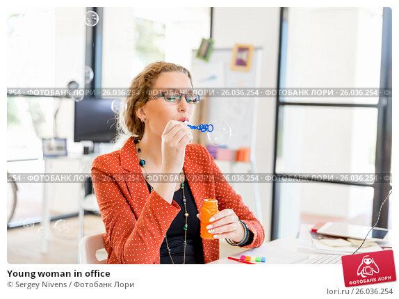 Купить «Young woman in office», фото № 26036254, снято 14 декабря 2014 г. (c) Sergey Nivens / Фотобанк Лори