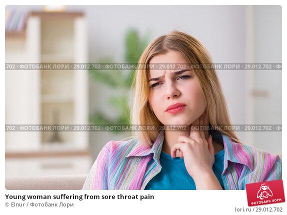 Купить «Young woman suffering from sore throat pain», фото № 29012702, снято 30 марта 2018 г. (c) Elnur / Фотобанк Лори