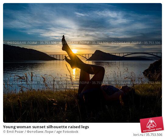Young woman sunset silhouette raised legs. Стоковое фото, фотограф Emil Pozar / age Fotostock / Фотобанк Лори