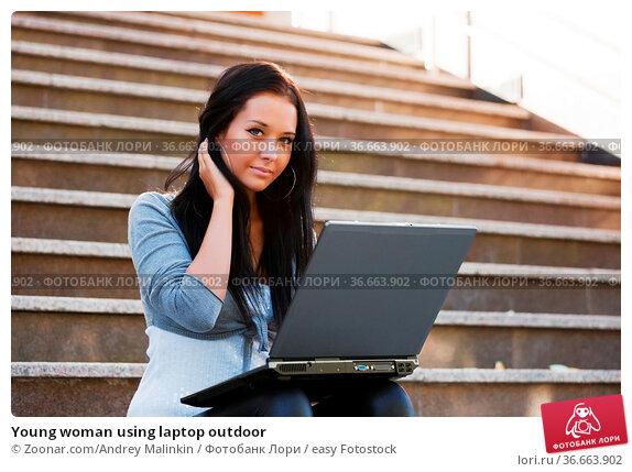 Young woman using laptop outdoor. Стоковое фото, фотограф Zoonar.com/Andrey Malinkin / easy Fotostock / Фотобанк Лори