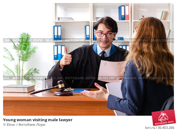 Young woman visiting male lawyer. Стоковое фото, фотограф Elnur / Фотобанк Лори