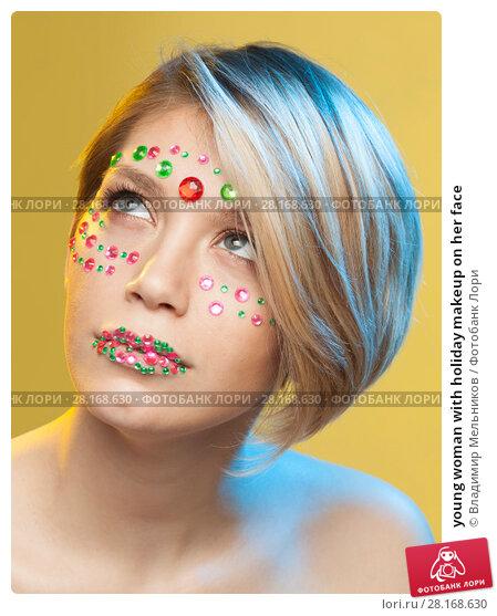 Купить «young woman with holiday makeup on her face», фото № 28168630, снято 12 декабря 2017 г. (c) Владимир Мельников / Фотобанк Лори