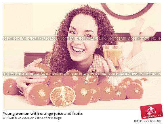 Купить «Young woman with orange juice and fruits», фото № 27039302, снято 20 апреля 2019 г. (c) Яков Филимонов / Фотобанк Лори