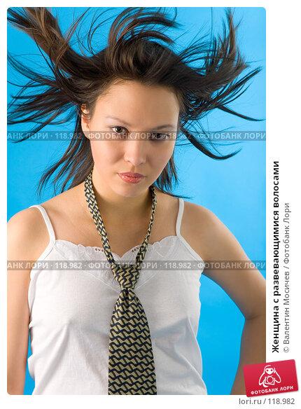 Купить «Женщина с развевающимися волосами», фото № 118982, снято 17 ноября 2007 г. (c) Валентин Мосичев / Фотобанк Лори