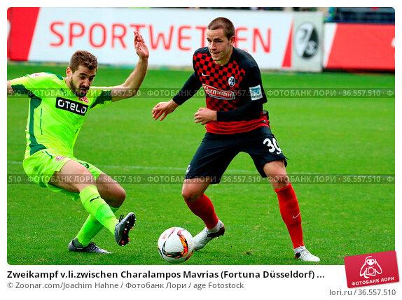Zweikampf v.li.zwischen Charalampos Mavrias (Fortuna Düsseldorf) ... Стоковое фото, фотограф Zoonar.com/Joachim Hahne / age Fotostock / Фотобанк Лори